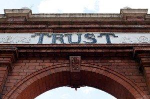 Trust Written Across a Brick Archway