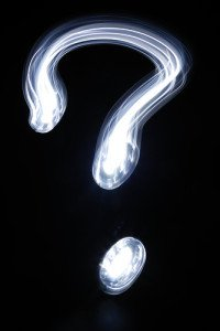 White Question Mark on Black Background