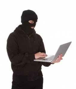 Burglar Wearing Mask Holding Laptop