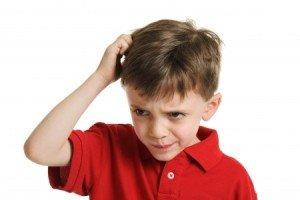 Little Boy Scratching Head