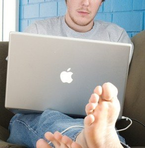 Man Working from Home Barefoot on Mac Laptop