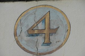 Number 4 Painted in Gold on a Wall