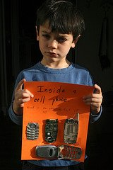 Boy with disassembled cell phone