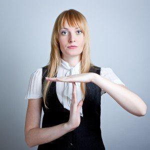 Woman Making Time Out Hand Signal