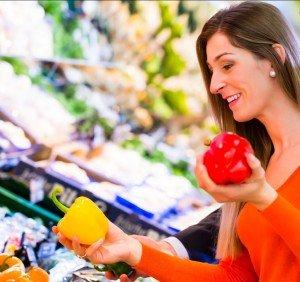 Woman Choosing Between Two Peppers