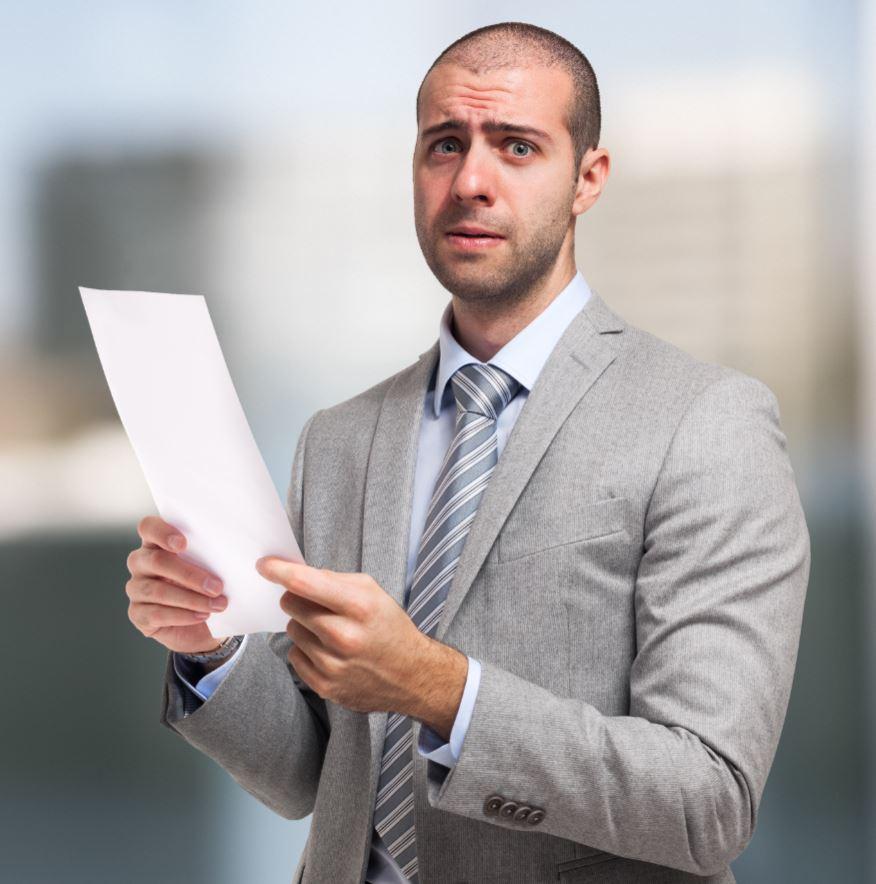 Sad Businessman Reading Bad News