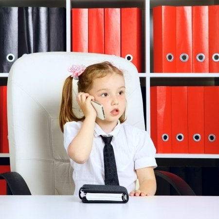 Young Girl on Phone in Office