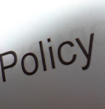 The Word Policy Typed on Paper