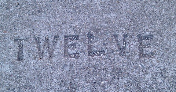 Word Twelve Stamped in Concrete