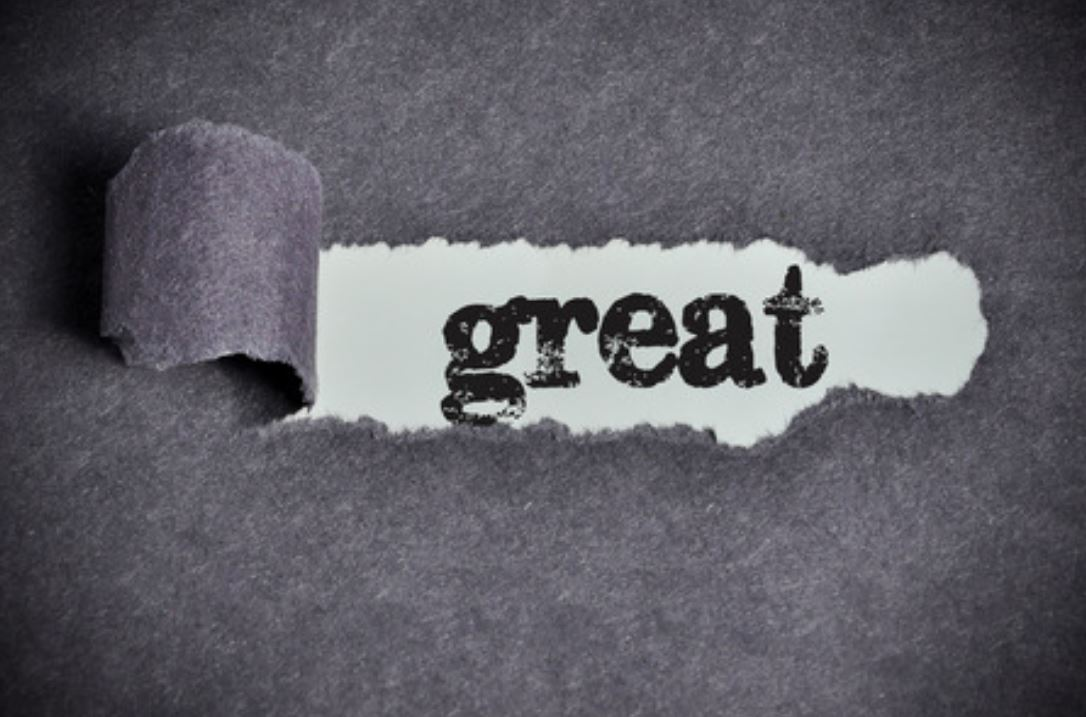 The Word Great Showing Through Ripped Paper