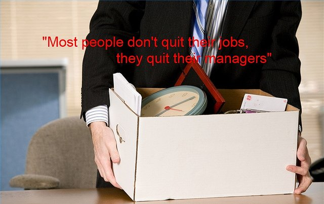 Man Quitting Job with His Stuff in a Box
