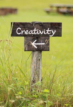 The Word Creativity Written on a Wooden Sign