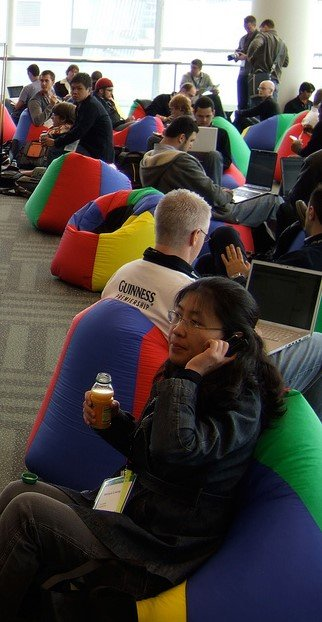 People Seated in Beanbag Chairs in Open Office Environment