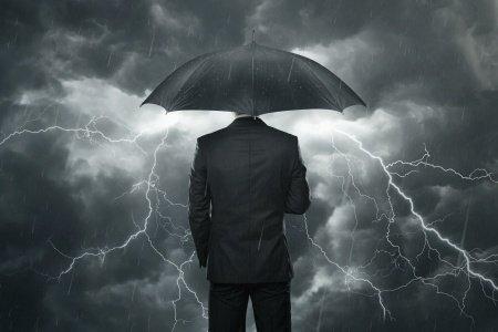 Man with Umbrella Facing a Storm