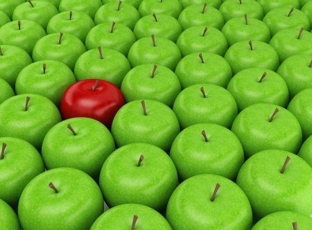 One Red Apple in a Group of Green Apples