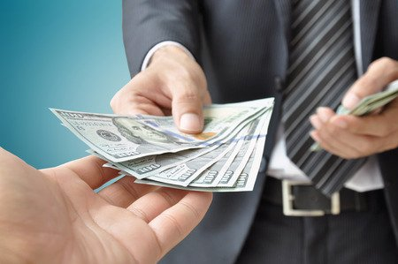 Hand Receiving Cash from Businessman