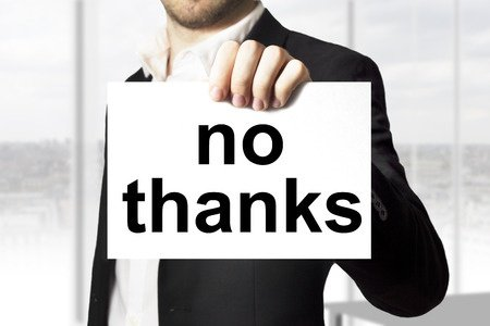 Businessman Holding No Thanks Sign