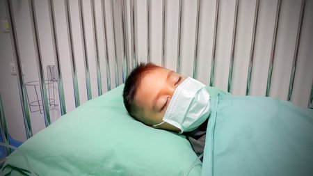 Indian Boy Wearing Mask in Hospital Bed