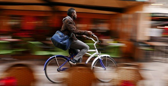 Man on a Bike in a Blur - Small